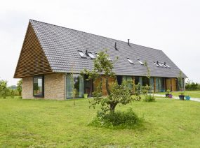 unique 16 person groupaccommodation Friesland Netherlands in an orchard