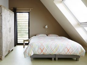 spacious master bedroom holiday home Friesland Netherlands